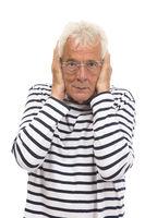 Senior man with hands on ear