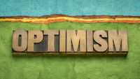optimism word abstract in wood type