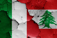 flags of Italy and Lebanon painted on cracked wall