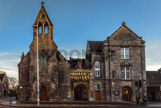 EDINBURGH, SCOTLAND DECEMBER 14, 2018: people walking along the street beside the front facade of The Queen's Gallery.