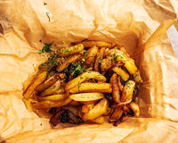 French fries. Tasty french fries on craft paper
