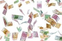 Money rain of Euro banknotes isolated on white background.