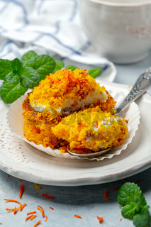 Traditional carrot cake with cream and crumbs.