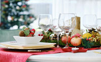 Decorated Christmas dinner table closeup view
