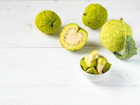 Green fruit of maclura, osage orange