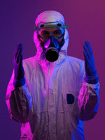 Doctor wearing protective biological suit and mask due to coronavirus