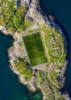 Football field stadium in Henningsvaer from above.