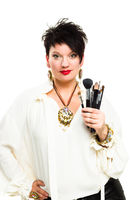 Attractive make-up artist with brushes on white background