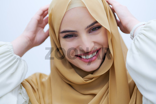 portrait of beautiful muslim woman isolated on white