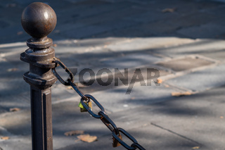 Padlocks attached to a chain in the streets