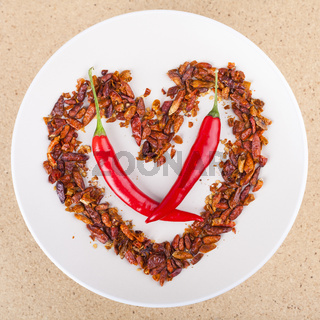 Hot chili peppers arranged in heart shape