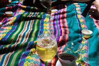 Fresh green tea on picnic blanket