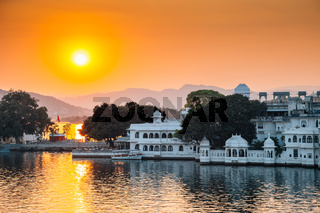 Sunset Pichola lake and Udaipur old town in India