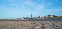 Beach of Warnemünde in Germany with view of the Landmarks Lighthouse and Teepott