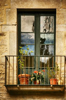 Spanish Windows with Balcony, Decorated With Fresh Flowers, Vintage Style