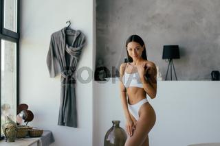 Woman In Bathroom. Fashion portrait model in bath.