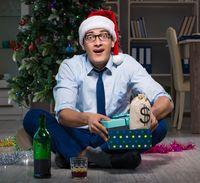Businessman celebrating christmas at home alone