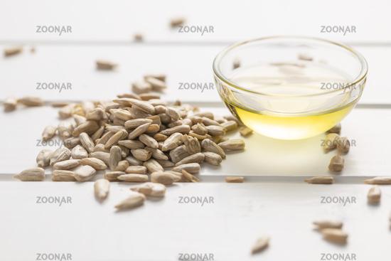 Peeled sunflower seeds and oil