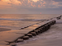 Groyne in the Baltic Sea near to Ahrenshoop, Mecklenburg-Western Pomerania, at sunset
