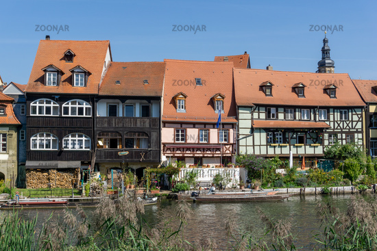 historic and colorful half-timbered houses on the banks of the Regnitz river in Bamberg in Bavaria