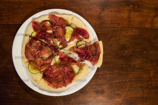 Italian pizza with bresaola, zucchini and eggplant