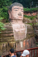 People looking at The majestic Giant Leshan Buddha