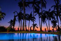 Boracay, Philippines - Jan 27, 2020: The pool is illuminated at night against the background of the sunset night sky. Diniwid beach during sunset.