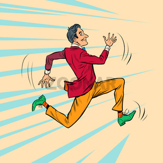 A hipster man in a bright stylish suit runs fast