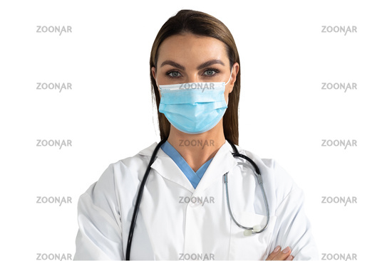 Portrait of female doctor wearing face mask against white background