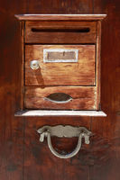 vintage wooden mailbox on a wooden door