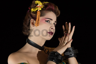 Woman in Geisha kimono in handcuffs and choker