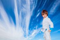 Handsome charming boy in a white kimono