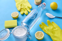 vinegar, lemons, washing soda, gloves and brush
