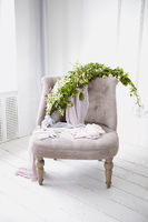Armchair with green branch and flowers