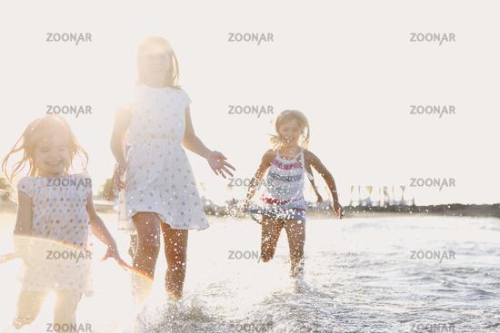 Happy kids running in sea water
