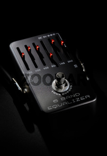 Close up view black color guitar pedal equalizer digital device for tone modifying