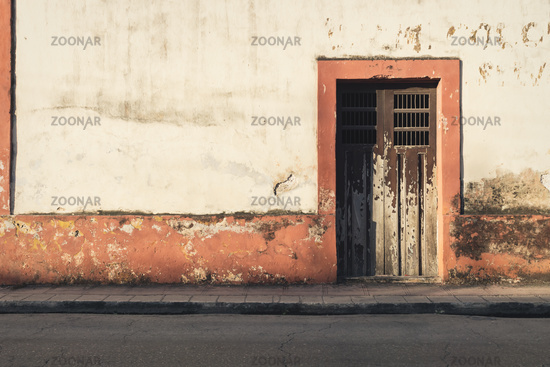 Abandoned colonial building facade during sunset, Valladolid, Yucatan, Mexico