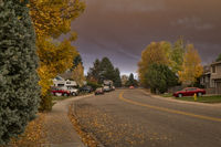 midday view of a residential street under heavy wildfire smoke plume