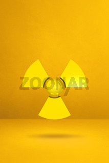 Radioactive symbol on a yellow studio background