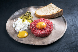 Gourmet tartar raw from beef fillet with yellow of the egg