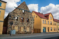 niemegk, germany - row of houses with the ruins of the old monastery