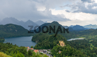 A panorama landscape view of Hohenschwangau Castle and Alpsee and Schwansee near Oberschwangau