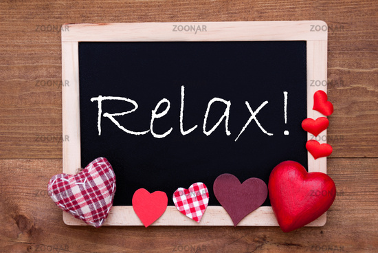 Balckboard With Red Heart Decoration, Text Relax, Wooden Background