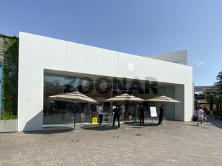 Apple retail store selling iPhones, iPads and more in sleekly designed spaces