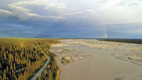 The Delta River makes it's way south from Fairbanks Alaska as a Rainbow Appears