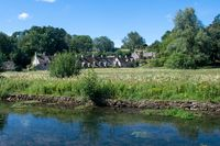Arlington Row Cottages in Bibury the Cotswolds with stream in  foreground