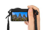 Hand with camera and Lempuyang temple in Bali Indonesia (my photo)