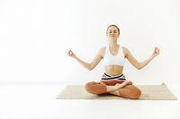 Slim woman meditating in Lotus pose
