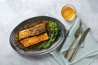 Grilled salmon with sesame seeds, wakame seaweed and wild rice