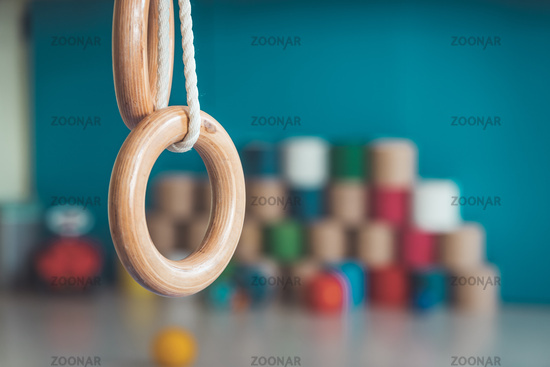 Physical education concept: Gym rings in gym hall of Kindergarten